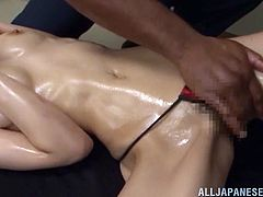 Sexy Japanese bitch Arisa Aizawa is playing dirty games with two horny studs. She sucks their BBCs devotedly and then welcomes the mighty rods in her snatch.