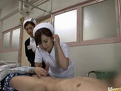 Kinky Japanese nurse comes up to a patient and takes his cock out of his pants. Then she gives him a blowjob on the eyes of another nurse.
