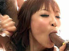 Sex starving busty Asian girl Misa Kikouden rides huge plastic dildo and works on two hairy pricks with her mouth. Check out her gorgeous oiled up curves!