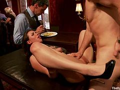 Hot babe sits on a table being tied up and gets her pussy drilled by a fucking machine. After that she gets fucked hard by a guy.