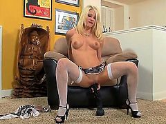 Helly Mae Hellfire reaches satisfaction using nothing but her dildo