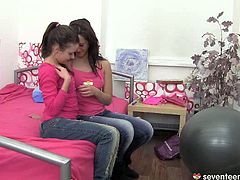 Two horn made young lesbians take clothes off each other before they start kissing passionately and oral stroking small perky tits.