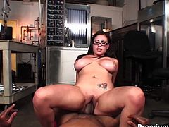 She is nasty four-eyed bitch with huge natural jugs. She rides the hard dick like crazy until the guy cums and shoots her boobs with load.