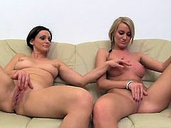 Brunette cougar and blonde girl strip their clothes off and lie down on a sofa. Then they spread their legs and finger their pussies.