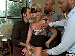 Sex addicted Karlo Karrera stands on her knees and sucks big dicks. Later on she lies down on a sofa and gets both her holes destroyed by horny guys.