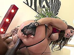 Tall babe oils up to take the two big fat black cock that are there to give her the screwing of her life.