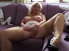 Blonde European mature Lucy looks damn fine. She has a pair of hot boobs, sexy thighs and between them a shaved pussy that needs pleasuring. The blonde shows us her delicious breasts and then lays on her back, spreads her thighs and fingers her cunt. Like it so far? Then stay with us for more!