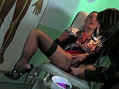 She looks hot in this satin black blouse and nice black stockings. She keeps her legs wide open and enjoys hot dildo doctor exploring her pussy.