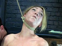 Blonde girl gets humiliated and tortured. After that she gets fucked from behind with strap-on by Isis Love. She also gets her vagina fisted.