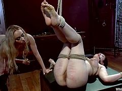 Amazingly hot brunette girl gets her ass spanked by a blonde. Later on she gets her body clothespinned. She also gets her vagina fisted and toyed with a vibrator.