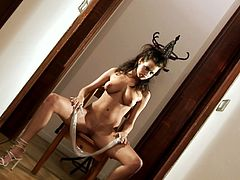 Check out this stunning dark-haired beauty getting naked and showing her sweet shaved pussy and natural tits with big nipples for your pleasure.