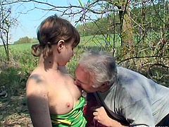 Curvy fresh faced amateur lies on the blanket outdoors while a rapacious grey-haired daddy joins her to receive a blowjob before she rides him in reverse cowgirl style.