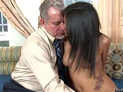 Petite sexy Ruby Rayes with provocative tattoos and slim sexy body gets naked while having fun with filthy mature fucker and takes on his cock in provocative action in living room