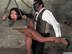 This petite and naughty Asian siren Soolin loves some sexual abuse. So babe gets gagged and tied on the yoke, which is hanged on chains.