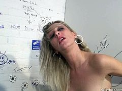 This blondie is in the public toilet. Slim whore sees a strong hot and surely tasty dick jutting out of the glory hole. This whorable bitch with natural tits can't just leave the WC till she gives a blowjob for sperm.