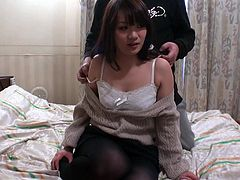 Sextractive Japanese hoe speaks on cam with seducing voice before a horny dude approaches her form behind to pet her round small tits and later tease her beaver with vibrator.