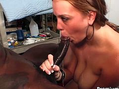 She is redhead Caucasian bitch with big natural jugs. She is fucking in a hardcore interracial porn movie. She gives the guy an awesome titjob.