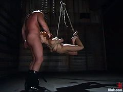 Gabriella Banks, a redhead beauty, is the one having rough oral sex in a bondage and domination session where her throat is fucked deep.