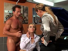 Mature manager sees her employee fucking a young rapacious slut in doggy pose right in the service station so she decides to join them for a steamy threesome orgy. Young slut tongue fucks her soaking pussy before riding a horny dude in reverse cowgirl style and finally pisses on aroused mature.