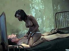 Nomad gets tormented and fucked by a hot ebony tranny Natassia Dream