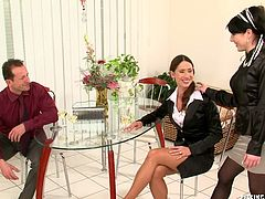 Two strict looking milfs in tight fitting suits make out with aroused daddy. He mauls their juicy asses intensively before he pokes them in turns in doggy pose through the holes in pantyhose in steamy threesome sex video by Tainster.