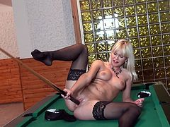 She looks desperate to fill her pussy with some thing. She is naked & doing some dirty work on the billiard table. Her nice pair of boobs are being rubbed by herself & then she is pushing her all fingers in her pussy. When she decides to go big she finds nothing but a big billiard stick and applies it.
