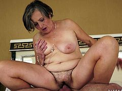Crazy granny kisses with younger guy. Then gets her old and hairy pussy licked. After that she gets fucked hard.