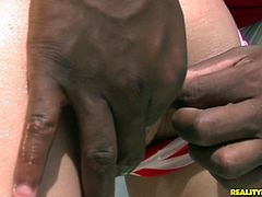 Perverse black daddy approaches a seductive blond babe that lies by the pool in steamy stripped bikini. She stands in doggy style in front of him to welcome a zealous finger fuck of her aroused shaved pussy in steamy sex clip by Reality Kings.