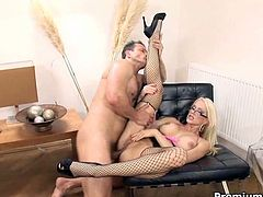 She wears sassy corset and fishnet stockings masturbating on stair. Horny young stud joins her and bangs her hardcore.