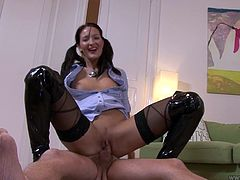 She is hot tempered brunette which is ready to ride your dick all night long. She rides Jim Slip right on the floor and after sucks his dick with a great pleasure.