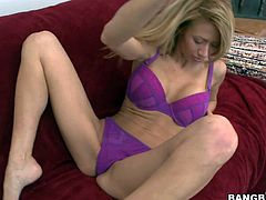 Slender amateur blonde Jandi Jenner with round fake tits and long legs in violet underwear slowly gets naked while teasing dirty dude at the interview filmed in point of view