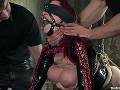 This is the dirties way of having a threesome sex. Two men tie Mz Berlin up and starts making her stun from a double penetration. Besides, her ass is hooked!