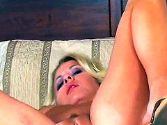 Riley Evans with gigantic knockers and shaved pussy masturbates like crazy
