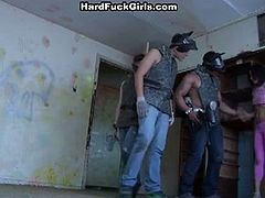 Three guys caught a girl in an abandoned house, immediately they start stripping her clothes and after some ass and pussy licking, she starts to give everyone great blowjobs.