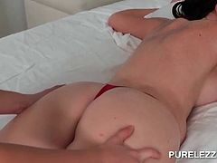 Hot titted naked lesbian getting a full body massage in bed