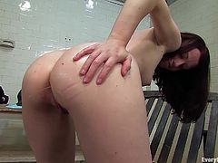 This sexy brunette will leave you speechless with her amazing ass. Watch her showing it off as she shoves a dildo in her pink pussy while getting an enema.
