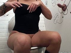Gosh, this blond slut is just frightening. Horn-mad nympho has wrinkled face, cellulitis big ass and droopy boobs. Whorish nympho in corset sees a dick jutting out of a glory hole and has a strong desire to be fed with sperm after a solid blowjob right in the dirty public toilet.