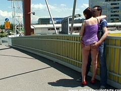 This brunette in short tight dress is fed up with wandering along the streets. Bitchie nympho with droopy ass wanna gain pleasure. She pulls up her dress and gets her pussy rubbed by a stranger. Pale hooker kneels down and repays with a solid blowjob for sperm right on the bridge.