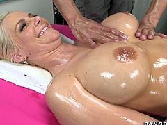 Horny blonde milf is lying down and she expects for some relaxation from this spa. She is right and the massage guy takes full care of her and gives a hell of a pussy rub. He is also groping her boobs and oiling her whole attractive body which makes his dick hard for this bitch to suck it badly.