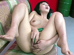 Alluring Japanese babe lies on a couch totally naked before she starts petting her big juicy tits and rubbing her shaved cunt with fingers in steamy solo sex video by Jav HD.