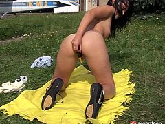Dazzling brunette hottie Peggy toys her pussy outdoors