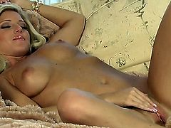 Niki Young with massive tits and bald twat masturbates enthusiastically