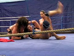 Larissa Dee, Diana Stewart and Emma Butt make a pretty hot threesome in the gym in wrestling ring and even hotter one after that under the showers with some sex toys