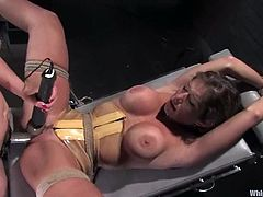 Adorable babe in latex nurse uniform whips another girl and ties her up. After that she also toys her pussy and fingers the ass.