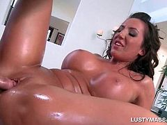 Busty brunette covered in oil taking masseurs cock deep in cunt