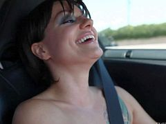Frisky brunette Belladonna is topless in her car. She demonstrates her natural tits and fucks her snatch with pink dildo while driving. Watch sexy bad girl Belladonna have crazy fun.