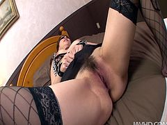 Naughty dark haired Asian woman Arakin Hitomi takes her clothes off and gets blindfolded. She spreads her thick legs wide open and gets her hairy snapper stimulated with high powered vibrator.