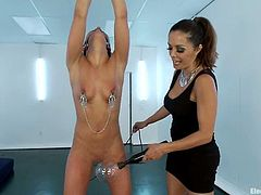 Stunning brunette girl gets her tits tortured with claws by Francesca Le. After that she gets her vagina licked and stuffed with a strap-on.