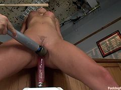 Stunning brunette girl undresses in the classroom. After that she toys her pussy with a vibrator and gets stuffed by the fucking machine.