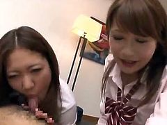 Adorable Japanese girls touch a dick in CFNM video. After that they drop to their knees and give great double blowjob to that lucky guy.